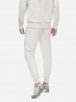 Спортивні штани New Balance MP03521SAH Молочні