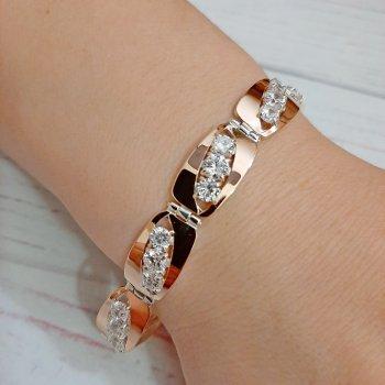 """Красивый женский браслет из серебра 925 пробы с золотыми пластинами 375 пробы и белыми фианитами """"Ария"""""""